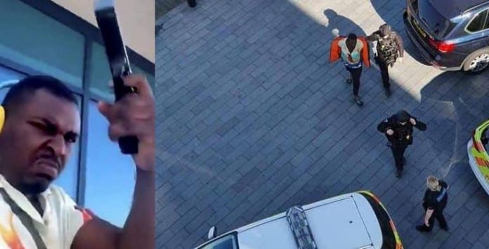 Nigerian man arrested in the UK after firing shots from the balcony while rapping to Tupac (Videos)